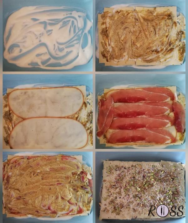 Iniziate quindi ad assemblare la lasagna. Coprite il fondo di una pirofila con un po' di besciamella e poggiatevi sopra uno strato di pasta. Condite con qualche cucchiaio di besciamella e qualcuno di pesto, mischiandoli leggermente fra loro.  Aggiungete qualche fetta di provola e di speck. Terminate con altra besciamella e pesto e ricoprite con un secondo strato di pasta. Procedete così con gli altri strati fino ad esaurire gli ingredienti. ( dovrete creare tre strati di ingredienti e quattro di pasta).