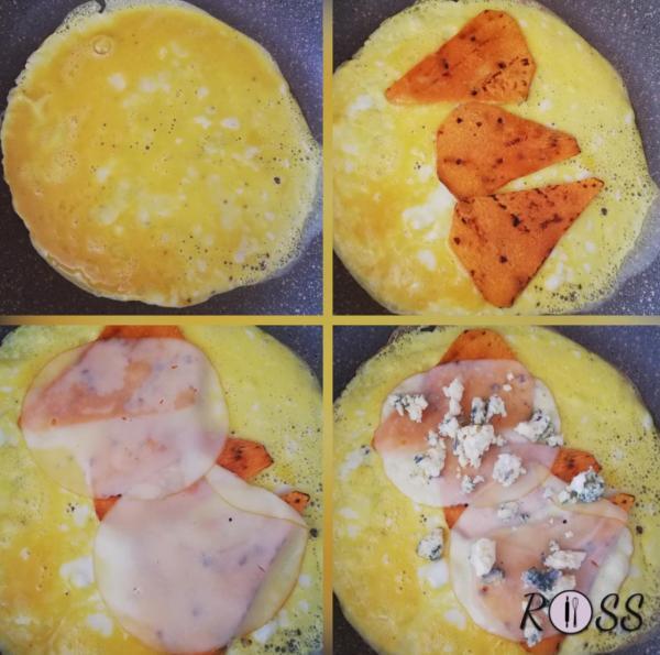 Sbattete 2 uova, unite un pizzico di sale e pepe. Su una padella antiaderente, con un filo d'olio, unite le uova sbattute e lasciate cuocere a fuoco basso. A metà cottura unite le fette di zucca, 3 fette di provola affumicata e 50 g di gorgonzola.